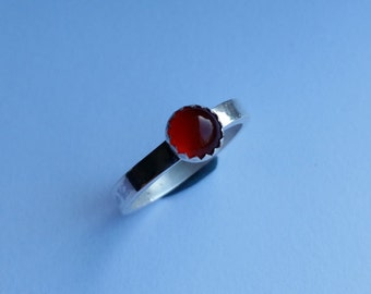 Silver ring with carnelian in ornamental settings