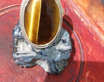 ring of Silver's law with stone semi-precious eye of Tiger.