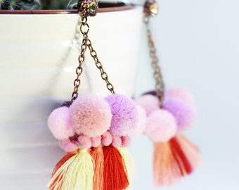 """Gipsy de Noiantri"" earrings pink and lilac with pom pom and tassels."