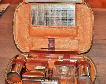 Then brown leather travel kit