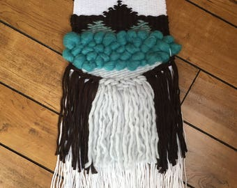 Teal, chocolate brown and white woven wall hanging