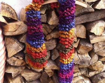 Hand knitted multi coloured scarf.