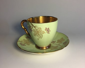 Demitasse Teacup and Saucer with Full Gilded Interior–Light Green, Gold, and Purple–Graceful Grapevine Patterns–Carlton Ware (England)