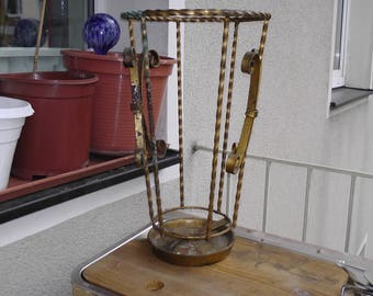Old wrought iron umbrella stand