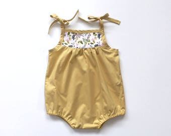 girls pale gold romper with floral detail