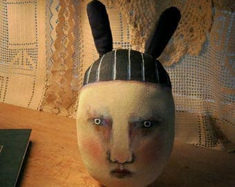 art doll head , sandy mastroni,rabbit ears  , whimsical, wall art doll , shelf art,