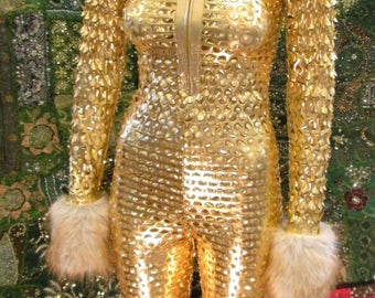 See-through Metallic Silver Laser Cut Spandex JUMPSUIT with FUR trim, zip up front, hood and pocket