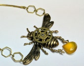 Busy Bee Keeper's Daughter - a unique necklace with a natural honey colored cut crystal stone