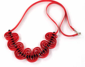 Red ribbon necklace with black beads