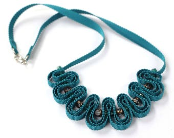 Teal ribbon necklace with glass beads