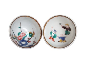 Pair of Vintage Japanese Saké Cups by Tamekichi Mitsui 3rd. Japanese Kutani Porcelain with Flowers and Playing Children. Pottery. Gui Nomi.