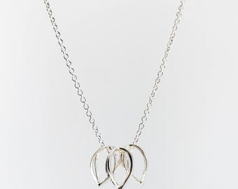 Geometric seed pod trio necklace. Handmade in sterling silver. Made to order.