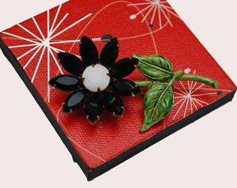 Rhinestone  Flower Brooch  - white milk glass black facet crystals petals - green enamel  Floral pin