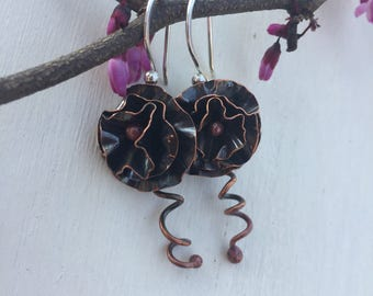 Calling all flower girls and hippie chicks. Pretty and feminine hand forged copper flower earrings with sterling silver ear wires. Boho.