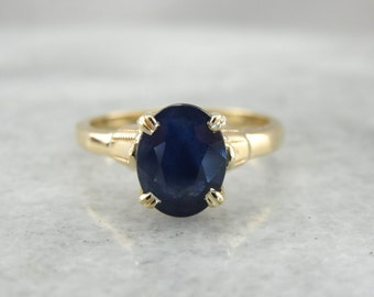 Deep Blue Sapphire Solitaire Ring in Yellow Gold AD2HZT-N