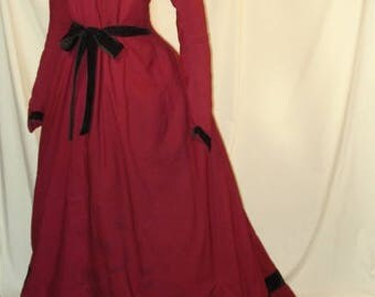 New photos of this great 1880s red wool dress with train.  Good displayable condition, not faded.  Blk velvt trim.