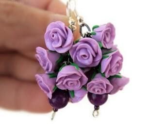 Earrings purple roses.