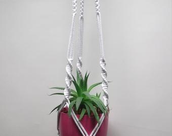 White cotton macrame plant hanger. Flowerpot hanger