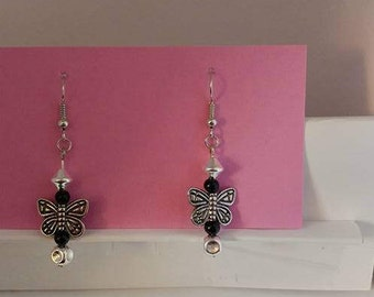 Silver bead with silver butterfly and silver fishhook