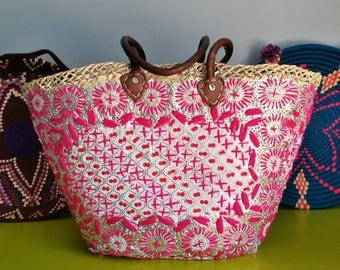 Basket woven and embroidered with floral patterns - handmade