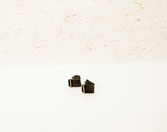 oxidised silver earrings with a golden rim
