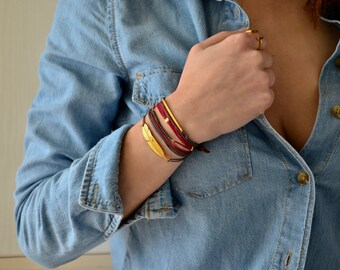 Multi wrap cord gold feather bar bracelet