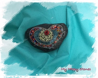 Heart on black stone