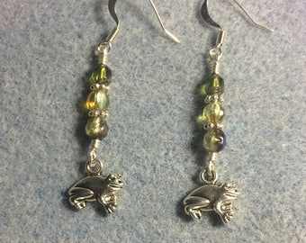 Small silver frog charm dangle earrings adorned with small olive green Czech glass beads.