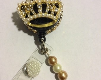 Goldtone crown with pearls and rhinestones retractable badge holder
