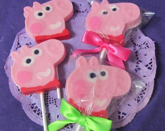 12 Peppa pig shaped chocolate lollipops