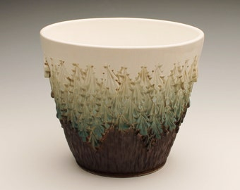 Teal colored carved bowl