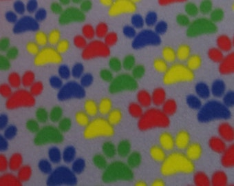 Paws Everywhere !  New Item  Custom Made Paw Print Fleece blanket with coordinating navy blue fleece back  Size 55x55