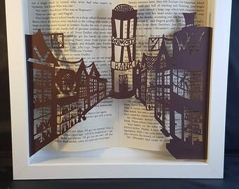 Diagon Alley handcut papercutting framed with Harry Potter book pages. Great present for a Harry Potter fan!
