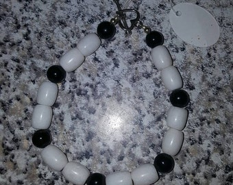 Black and white beaded bracelet with heart shaped t bar