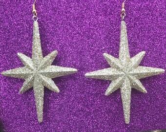 Gold atomic star dangle earrings