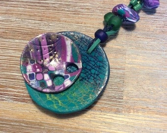 Abstract pendant in polymer clay - mauve, turquoise, dark mauve and dark blue