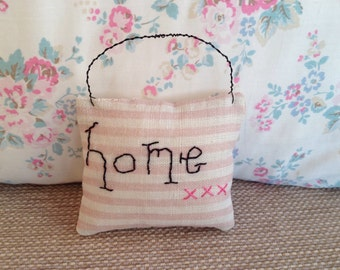 Plush Home sign