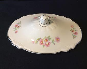 A Homer and Laughlin serving bowl/casserole lid  size 9.25 L; 7 W  in Virginia Rise