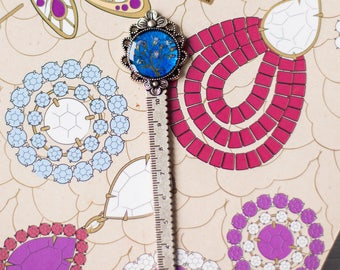 Bookmark - ruler for the book with forget me not flowers.