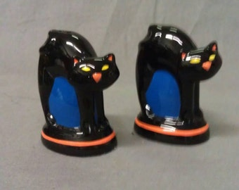 Black Cats over Blue Barrel ?? With Orange Ears and Mouth and Yellow Eyes Salt and Pepper Shaker Set