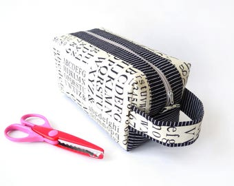 Zippered boxy pouch/make-up/cosmetic pouch with handle, with the alphabet and numbers on off-white and black and white striped accents