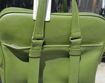 Vintage avocado green travel bag.