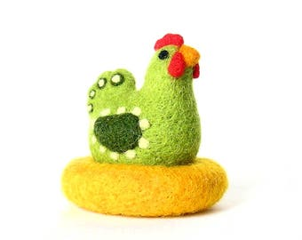 Green hen in her nest. Figurine in felted wool