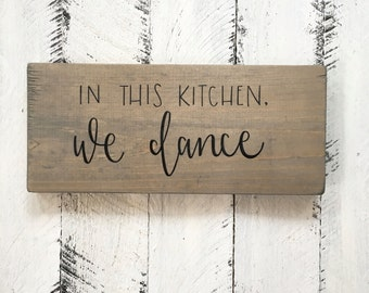 In This Kitchen, We Dance - Wood Sign
