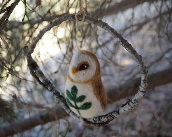 Needle felted barn owl on a wooden circle