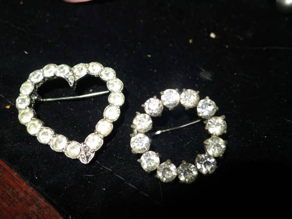 Lovely pair of vintage silver metal rhinestone heart and circle brooches