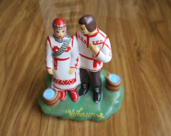 Handmade clay painted figurine couple in love in the Chuvash national costume