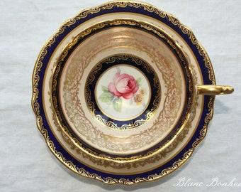Paragon, England:  Tea cup and saucer, cobalt blue with dark pink rose
