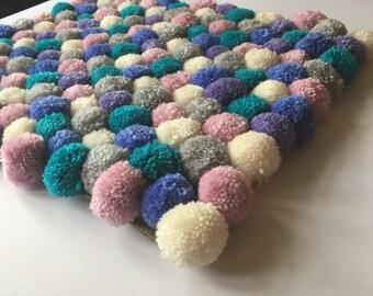 Pompom Rug, Multicoloured handmade pompom rug, pastel coloured pompom childrens bedroom rug, small bedroom rug, pompom doormat