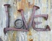 LOVE word art, railroad spike art, metal words art decor, rustic home decor, shelf decor, welded metal art, scrap metal decor, primitive art